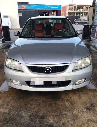 Mazda 323 gasolina