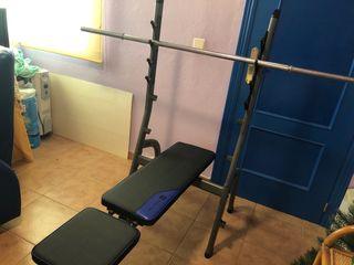 Banco de pesas regulable con barras y mancuernas