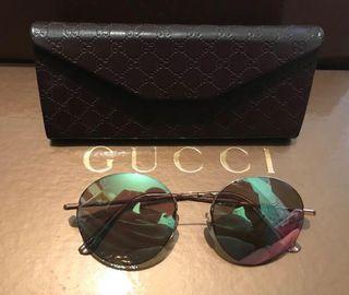 Gafas Round Gucci