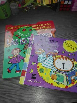 2 libros con Pop UPS y discos giratorios