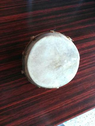 Shaker artesanal en coco y piel