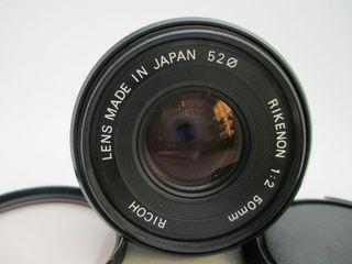 objetivo de cámara de fotos con cámara de carrete