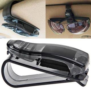 Pinza sujeta gafas para el coche