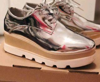 Blutcher zapatos