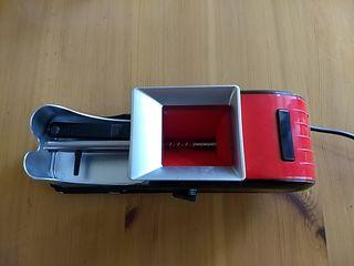 Máquina de entubar tabaco.