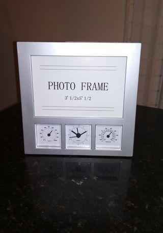 Marco foto y reloj atmosférico
