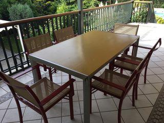 Mesa de exterior y 6 sillas