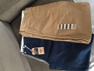 Pantalones Dockers nuevos (dos pares).