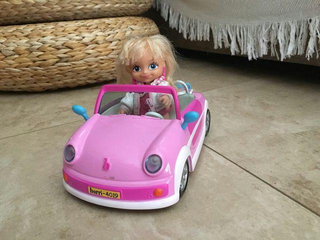 Muñeca barriguitas con coche