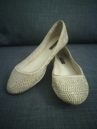 Beige and gold shining ballerinas