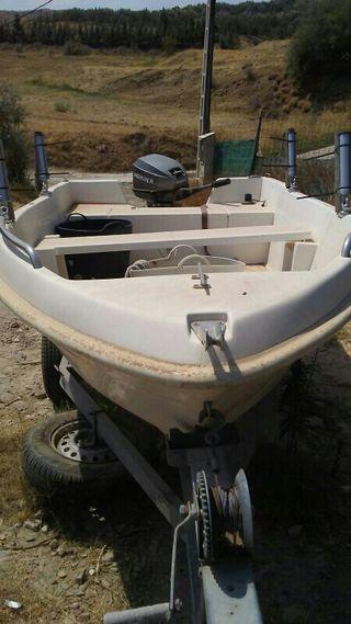 barca con motor de 15 caballos