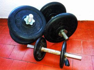 Mancuernas caucho 20kg. cada una, anillo de acero.