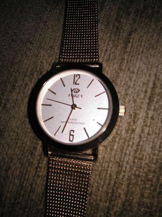 reloj nuevo marea color rosado