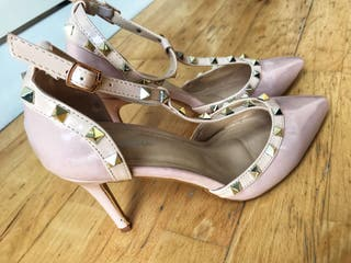 Nude patent studded court heels
