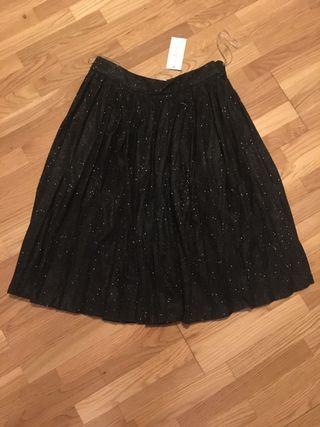 Falda negra com brillos