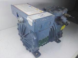 Compresor frigorífico semi hermético.