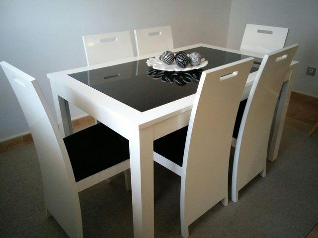 Mesa de comedor de diseño con 6 sillas. de segunda mano por 550 € en ...