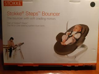 Hamaca Stokke Steps bouncer con funda azul