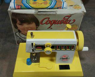 Maquina de juguete que cose de verdad .Perfecta