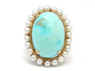 Sortija oro 18 K con turquesa orlada de perlas