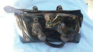 Pequeño bolso trasparente color cobre /dorado