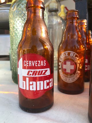 Botellín cruz blanca
