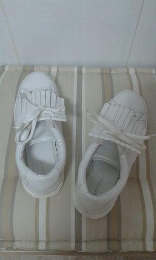Zapatillas con solapa
