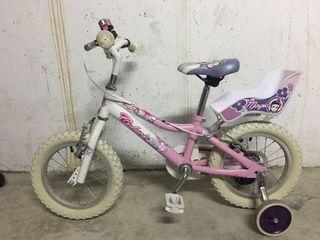 Bicicleta de niña con ruedines.