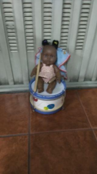 Tambor con muñeca