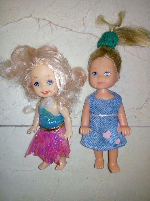 2 muñequitas vestidas