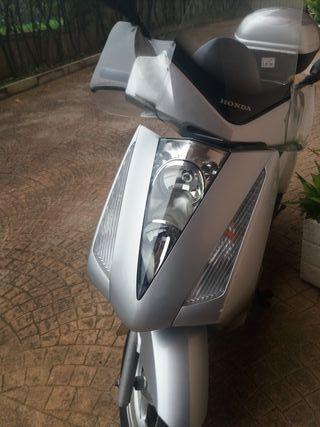 Vendo o cambio Moto Honda 125cc