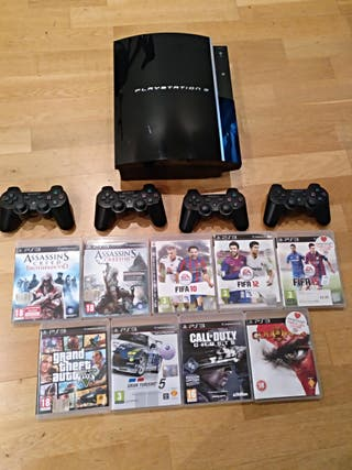Ps3 + 4 controllers + 9 games