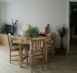 Extendable wooden table and four chairs