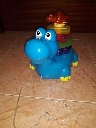 Dinosaurio apilable con luz y sonido .