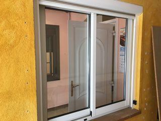 Ventana aluminio blanca cámara vidrio doble