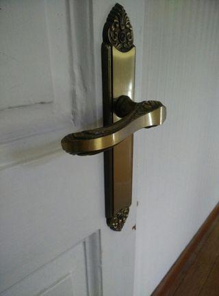 Manilla puerta bronce