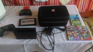 Nintendo switch con juegos y accesorios