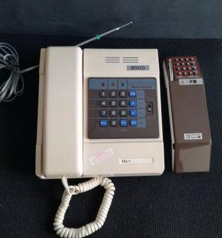 Antiguo teléfono vintage doble auricular