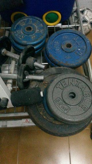 pesas de 10 de 5 y 20 kilos con 2barras y 2mancuer