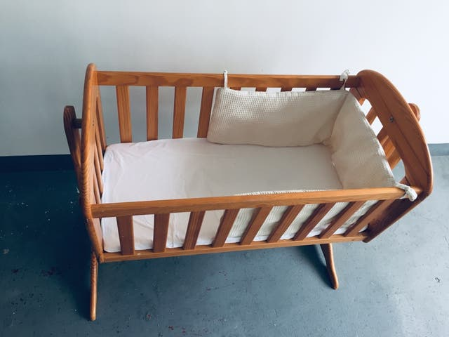 Wooden baby sleep cot