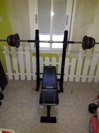 banco de pesas con barra