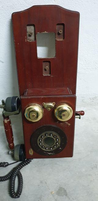 Teléfono antiguo tal cual está en las imágenes.