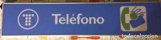 Antiguo cartel cabina telefónica con marco