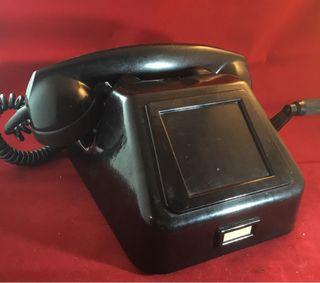 Teléfono antiguo negro PTT Ericsson con magneto