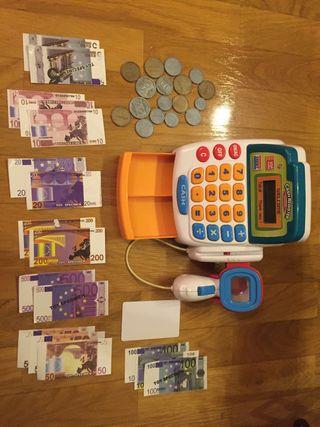 Caja registradora con dinero de juguete.