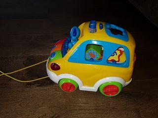 Coche de juguete con sonidos y piezas