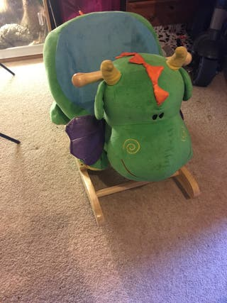 Sit on rocking dragon toy