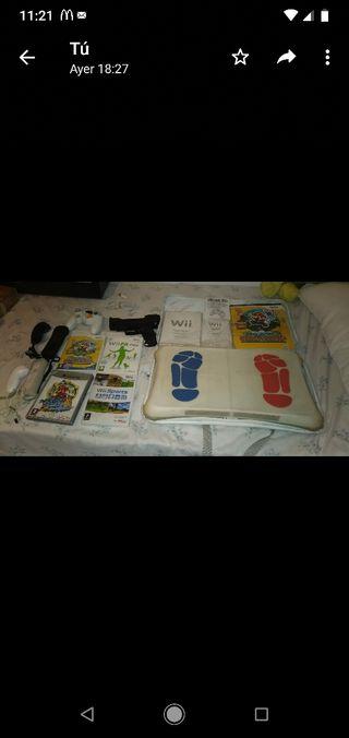 nintendo wii + 2 mandos + juegos + tabla + extras
