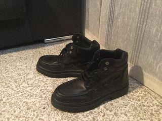 Botas negras de piel hombre