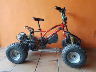 quad infantil electrico a pedales.